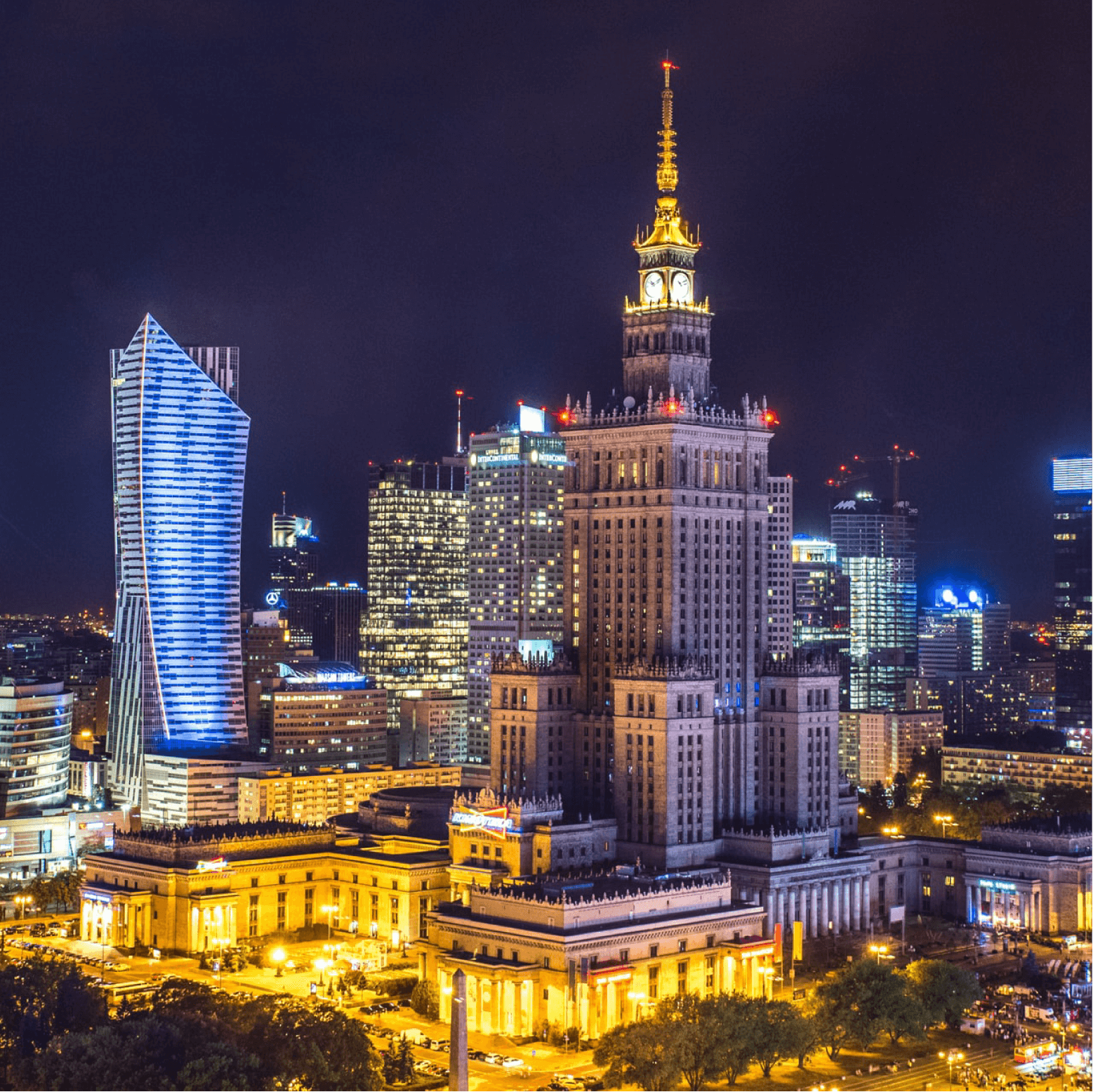 Aerial View of Warsaw City Center with Palace of Culture and Science and Other New Skyscrapers by night