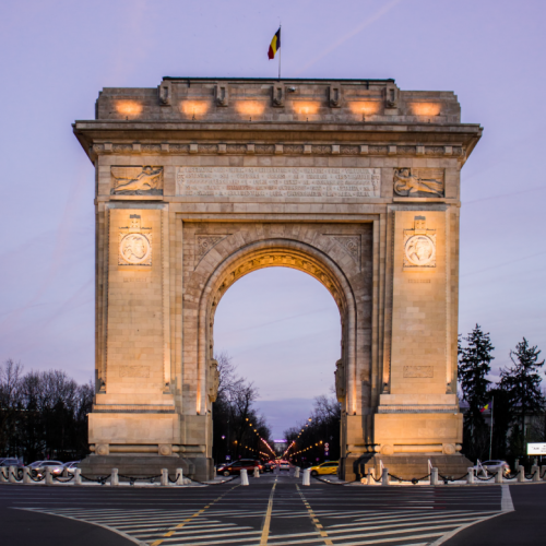 Sunset front view of Arc de Triomphe in Bucharest, Romania